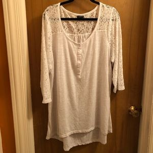 White shirt with long lace-like sleeves